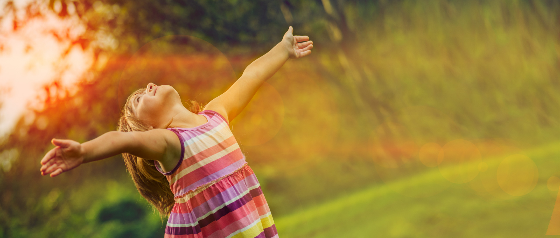 Beautiful girl enjoying the sun with outstretched arms